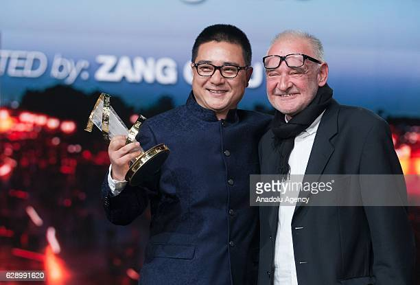 """Chinese director Zang Qiwu receives the Golden star for the film """"The Donor"""", from Hungarian director Bela Tarr during the closing ceremony of the..."""