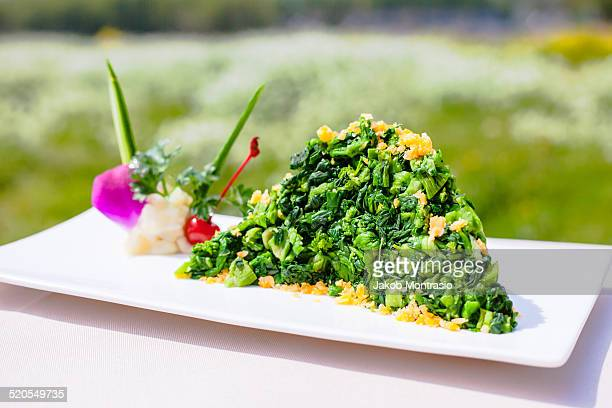chinese dish sauteed pea shoots - jakob montrasio stock pictures, royalty-free photos & images
