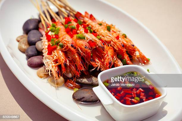 chinese dish shrimp sticks on hot stones - jakob montrasio stock pictures, royalty-free photos & images