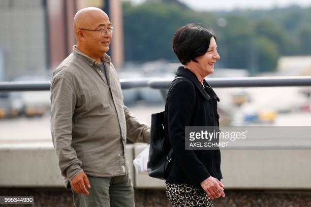 Chinese dissident and writer Liao Yiwu and German writer and Nobel Literature Prize laureate Herta Mueller wait for Liu Xia the widow of Chinese...