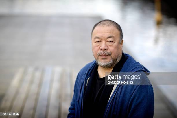 Chinese dissident artist Ai Weiwei poses during the Amsterdam Light Festival in Amsterdam on November 29 2017 Original artworks by Weiwei will be...