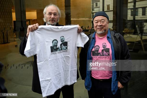 Chinese dissident artist Ai Weiwei poses for a photograph with John Shipton, the father of Wikileaks founder Julian Assange, outside the Old Bailey...