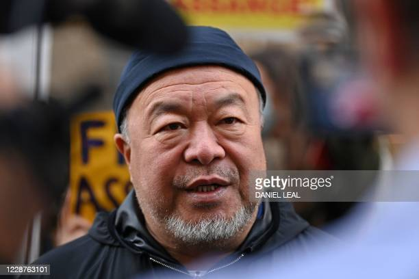 Chinese dissident artist Ai Weiwei speaks to members of the media outside the Old Bailey court in central London on September 28 where the...