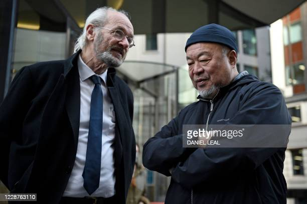 Chinese dissident artist Ai Weiwei speaks with John Shipton , the father of Wikileaks founder Julian Assange, outside the Old Bailey court in central...