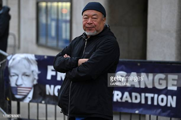 Chinese dissident artist Ai Weiwei stages a silent protest in support of Julian Assange outside of the Old Bailey court in central London on...