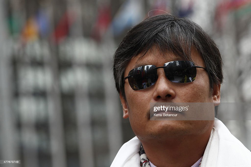 Chinese dissident Chen Guangcheng (C) attends the 55th anniversary of the Tibetan national uprising day rally outside the United Nations buiding on March 10, 2014, in New York City. On this day in 1959, an uprising against China's occupation of the autonomous region of Tibet took place, forcing spiritual leader the Dalai Lama to flee into exile.