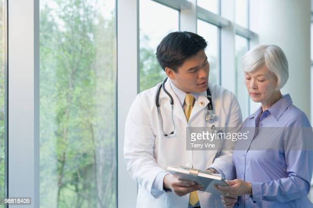 Chinese doctor talking to woman