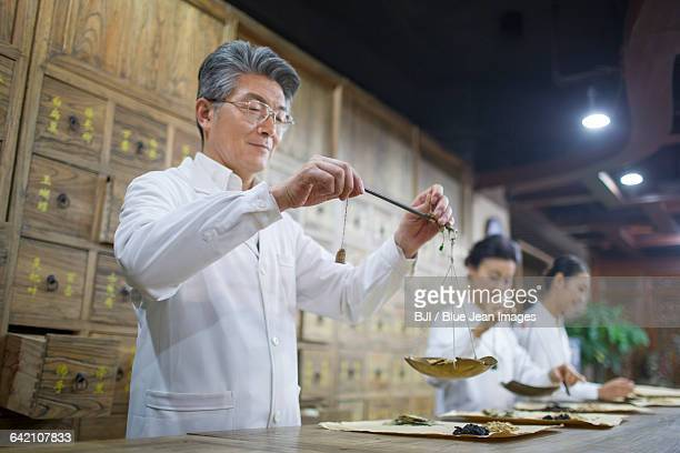 Chinese doctors in traditional Chinese medicine pharmacy