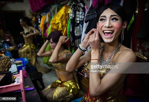 Chinese drag queen Baomei laughs while getting ready before performing at the Chunai 98 club on January 10 2015 in Nanning Guangxi Province southern...