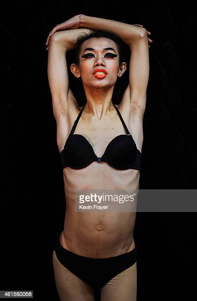 A Chinese drag queen who goes by the stage name of Wudi poses at the Chunai 98 nightclub on January 10 2015 in Nanning Guangxi Province southern...