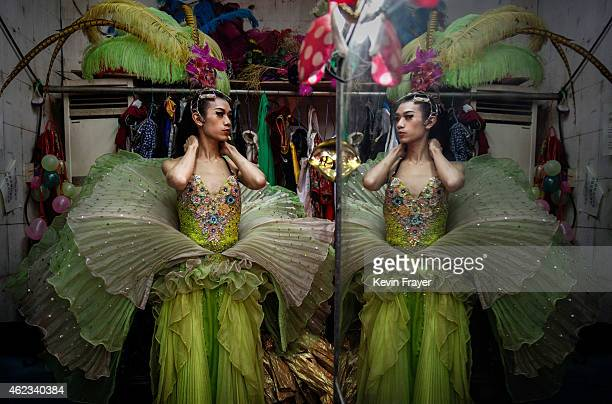 Chinese drag queen who goes by the stage name Wudi looks in the mirror before performing at the Chunai 98 club on January 9, 2015 in Nanning, Guangxi...
