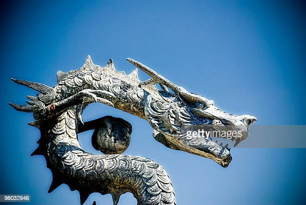 chinese  dragon statue  - chinese dragon stock photos and pictures