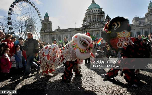 Chinese Dragons lead the Saint Patricks day celebrations in Belfast.