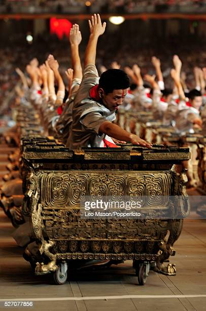 Chinese drummers perform during the Opening Ceremony of the Beijing 2008 Olympic Games at the National Stadium, known as Bird's Nest, Beijing, China.