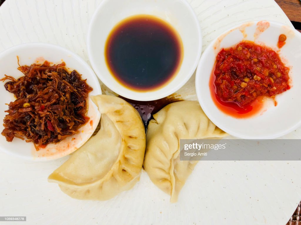 Chinese dumplings with dips : Stock Photo
