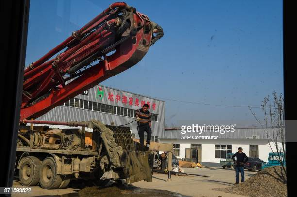 Chinese employees of a company work on the premises of a factory in Suining County at Jiangsu province on November 8 2017 US president Donald Trump...