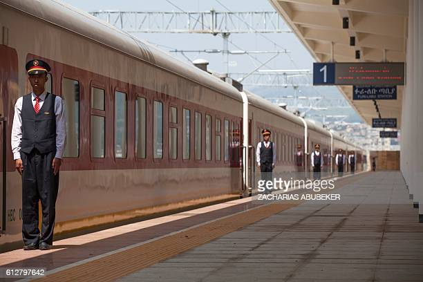 Chinese employees of the Addis Ababa / Djibouti train line stand at the Feri train station in Addis Ababa on September 24 2016 With Chinese...