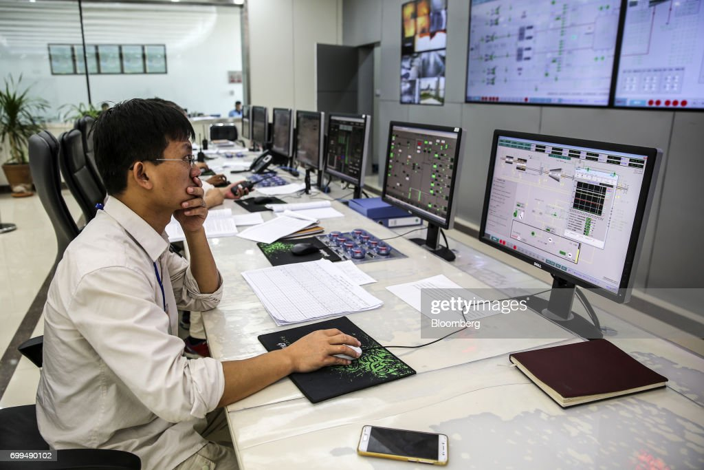 A Chinese engineer works in a control room at the Sahiwal coal power plant owned by China`s stateowned Huaneng Shandong Rui Group in Sahiwal Punjab...
