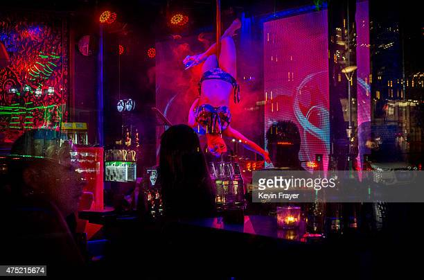 Chinese entertainer perfomers a poledance at a bar on May 29 2015 in Beijing China