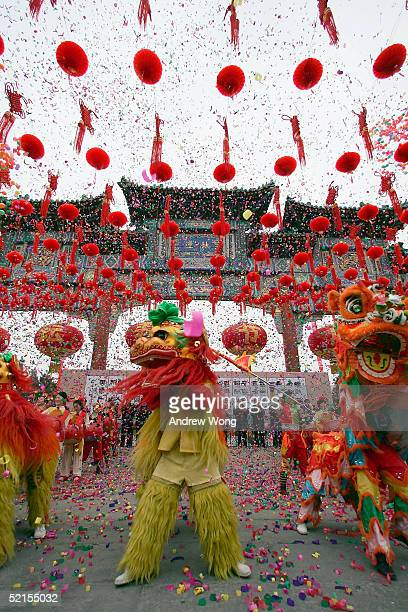 Chinese entertainers perform a lion dance at Temple of Earth on the eve of Chinese New Year February 8, 2005 in Beijing, China. Chinese started...
