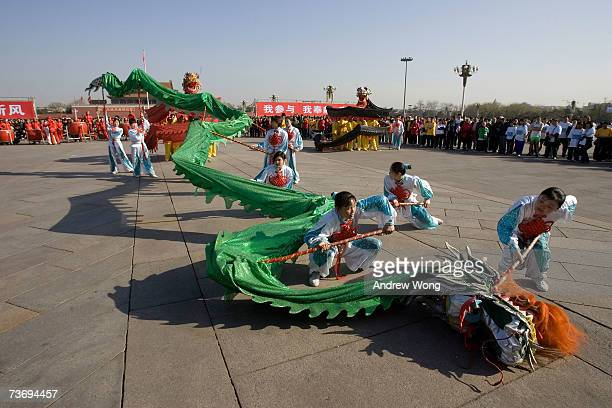 Chinese entertainers perform a traditional dragon dance on Tiananmen Square before the start of Beijing International Long Distance Running Festival...