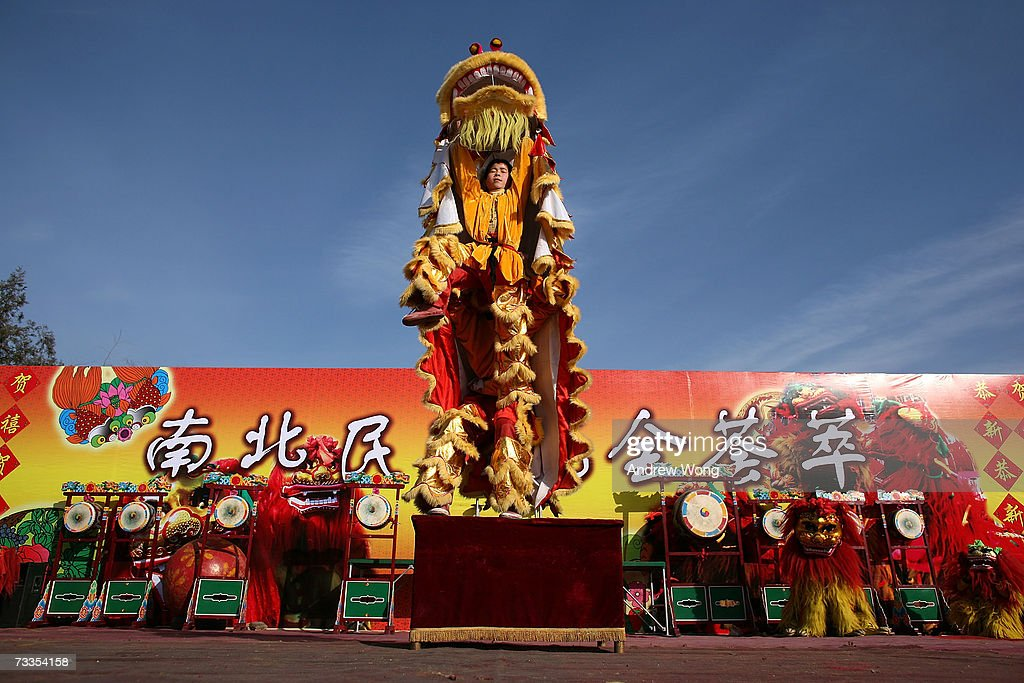 chinese entertainers perform a traditional lion dance at a temple fair to celebrate the upcoming chinese - Chinese New Year 2007