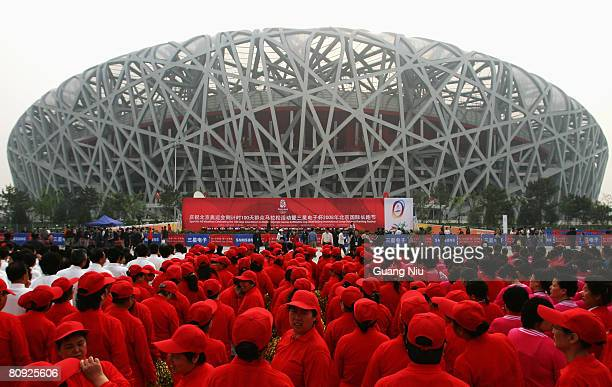 Chinese entertainers wait to perform in front of the National Stadium, also known as the 'Bird's Nest' ahead a long-distance race on April 30, 2008...