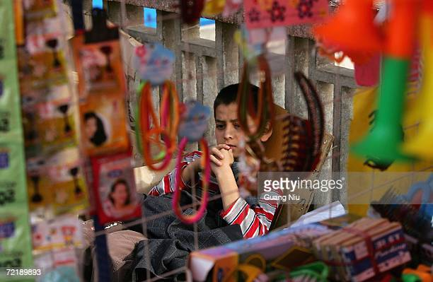Chinese ethnic minority child sells groceries at a bazaar on October 15 2006 in Kashgar city Xinjiang Uygur Autonomous Region China Known as East...