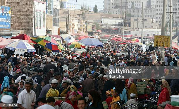 Chinese ethnic minority gather at a bazaar on October 15 2006 in Kashgar Xinjiang Uygur Autonomous Region China Xinjiang has been noted in ancient...