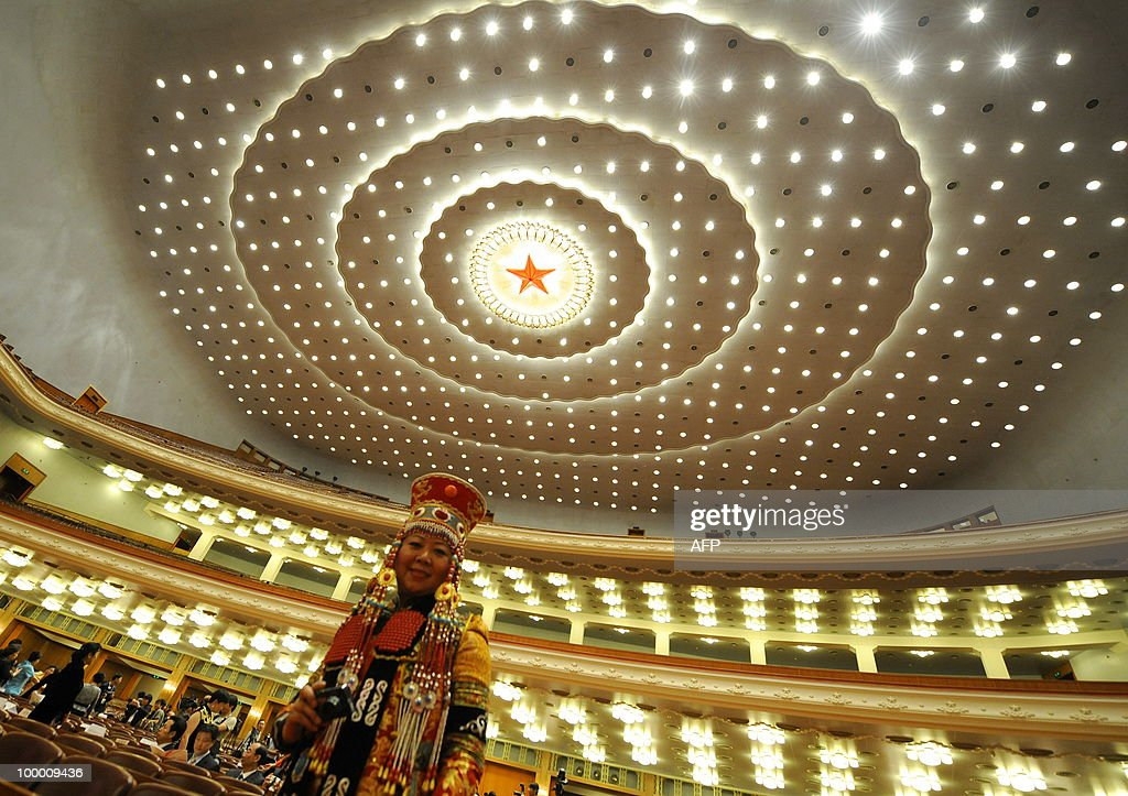 A Chinese ethnic Mongolian lady arrives for the opening ceremony of the 20th Global Summit of Women at the Great Hall of the People in Beijing on May 20, 2010. More than 1,000 women delegates from 80 countries participate in the Global Summit of Women in China's capital from May 20-22, 2010. AFP PHOTO/LIU Jin