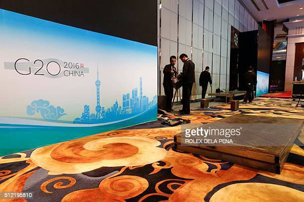 Chinese event staff prepare the meeting room one day before the start of the G20 Finance Ministers and Central Bank Governors Meeting at the Pudong...