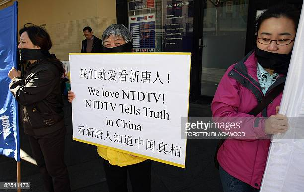 Chinese expatriates condemning media censorship in China wear gags over their mouths during a protest in Sydney on August 24 2008 Australia's Chinese...