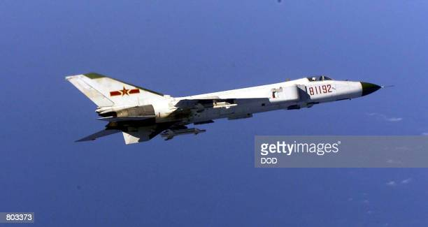Chinese F8 jet fighter flys close to a US Navy aircraft January 24 2001 as it monitors the US surveillance plane in this Department of Defense photo...