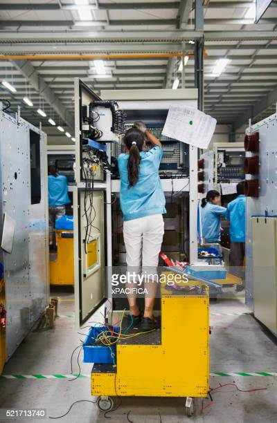 chinese factory worker working on wiring a switchgear assembly - changzhou stock pictures, royalty-free photos & images
