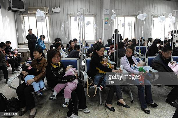 Chinese familes accompany their children as they get various injections from flu to rabies shots at a hospital in Hefei central China's Anhui...