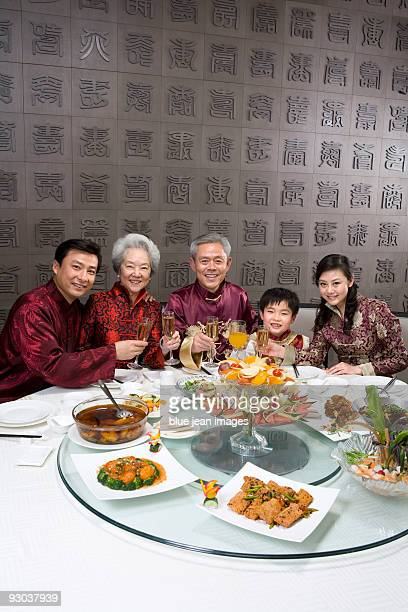 Chinese family celebrating at Chinese restaurant