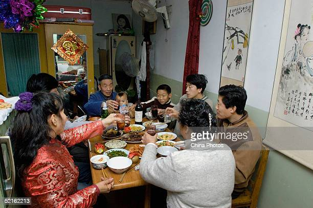 A Chinese family eat the New Year's Eve Dinner on February 8 2005 in Beijing China The dinner is one of the most important events to celebrate the...
