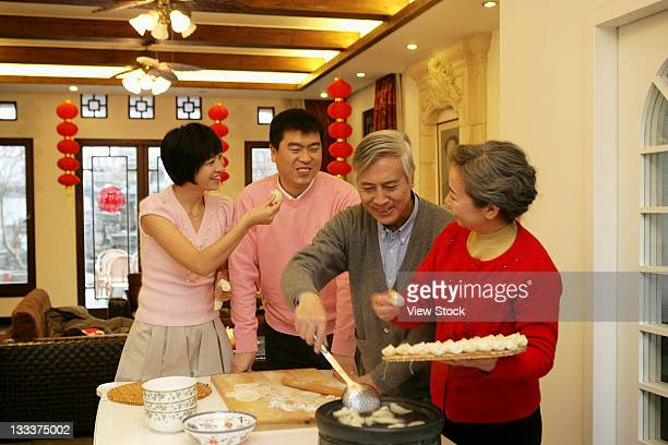Chinese family making Chinese dumpling on New Years Eve
