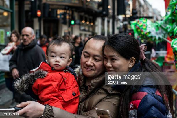 A chinese family seen enjoying their time in London's Chinatown Londoners gather in London's chinatown and trafalgar square to celebrate Chinese new...