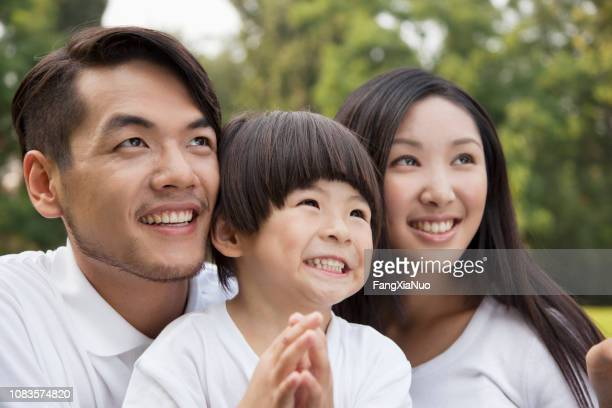 chinese family smiling - family with one child stock pictures, royalty-free photos & images
