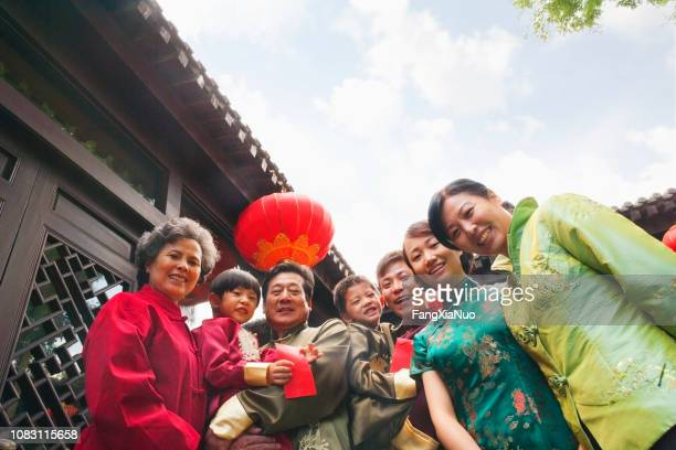 chinese family wearing traditional clothes - chinese culture stock pictures, royalty-free photos & images