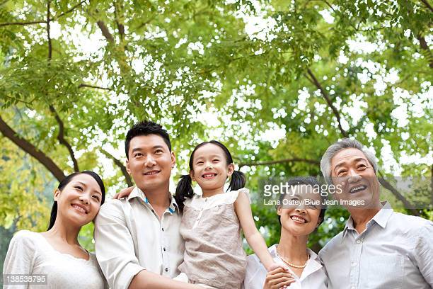 Chinese family with grandparents in a park