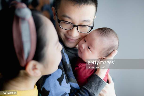 chinese family with one baby boy - chinese ethnicity stock pictures, royalty-free photos & images
