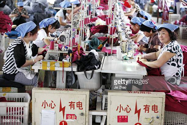 Chinese famle labors work at a cloth factory in Huaibei, Anhui province, east China June 1 2015. The official purchasing managers' index , which...