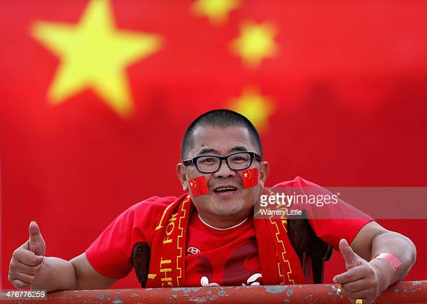 A chinese fan cheers his team on during the Asian Cup Qualification match between China and Iraq at the AlSharjah Stadium on March 5 2014 in Sharjah...