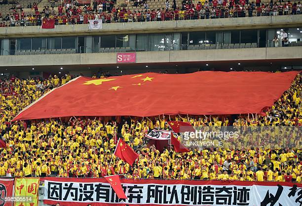 Chinese fans carry a huge national flag during the 2018 World Cup qualifying football match between South Korea and China in Seoul on September 1...