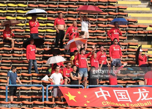Chinese fans celebrates after Yang Liyu scored from the spot during the AFC U23 Championship qualifier between China and Laos at Shah Alam Stadium on...