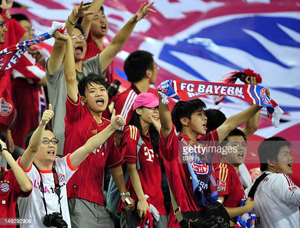 Chinese fans of Bayern Munich cheer their team on against Wolfsburg in Guangzhou south China's Guangdong province on July 26 2012 Bayern Munich beat...