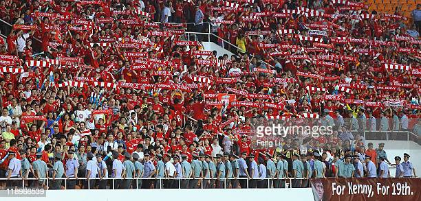 Chinese fans of Liverpool celebrate winning after the preseason friendly match between Guangdong Sunray Cave and Liverpool at Guangdong Provincial...