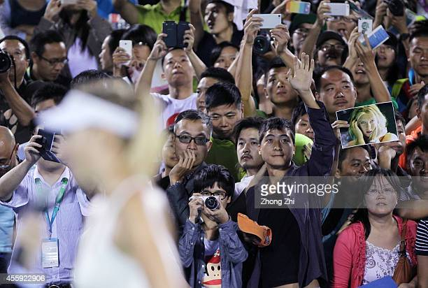 Chinese fans of Maria Sharapova after her match against Svetlana Kuznetsova of Russia on day two of 2014 Dongfeng Motor Wuhan Open at Optics Valley...